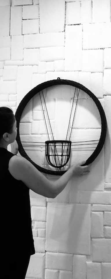 Owner and Founder of BPOSCH Interior Design Olga aligning a wall accessory